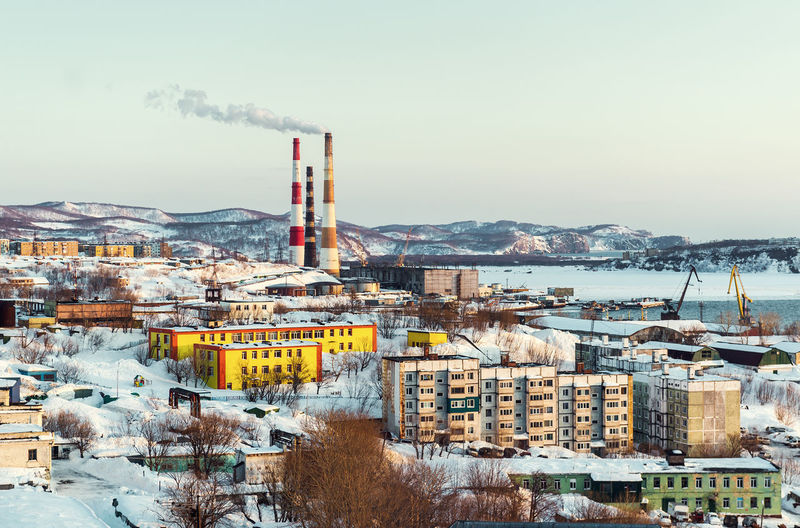 Chimneys In City During Winter