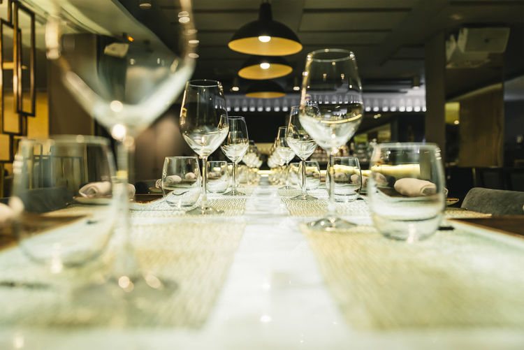 Table Wineglass Glass Food And Drink Glass - Material Selective Focus Business Restaurant Indoors  Drink Household Equipment Drinking Glass Wine In A Row Arrangement Refreshment Transparent Alcohol No People Furniture Setting Luxury Copy Space Lunch Dinner Party