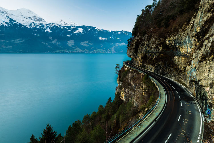 Mountain road by sea during winter