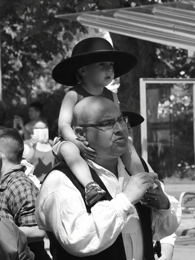 Father and son close-up. Traditional Festival Outdoors People Adult Men The Street Photographer - 2017 EyeEm Awards Live For The Story Monochrome Monochrome Photography Black & White Black And White Place Of Heart Out Of The Box Family Father And Son Fatherhood Moments Father The Portraitist - 2017 EyeEm Awards The Photojournalist - 2017 EyeEm Awards Arts Culture And Entertainment Period Costume Togetherness Child Celebration Childhood