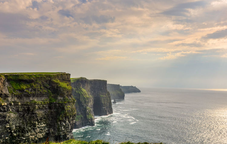 The walk to Infinity Amazing View Awe Beauty Beauty In Nature Cliffs Cliffs Of Moher  Cloud - Sky Day Hiking Idyllic Infinity ∞ Ireland🍀 Landscape Nature No People Outdoors Rock - Object Scenics Sea Sunrays Sunset Tourism Tranquility Travel Water EyeEmNewHere