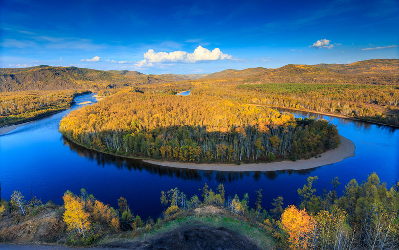 Bairu Island in the middle of winding river, color of autumn in northeast China Aerial View Autumn Beauty In Nature Blue Sky Day Golden Island Lake Mountain Nature No People Outdoors Reflection Scenics Sky Tranquil Scene Tranquility Tree Water