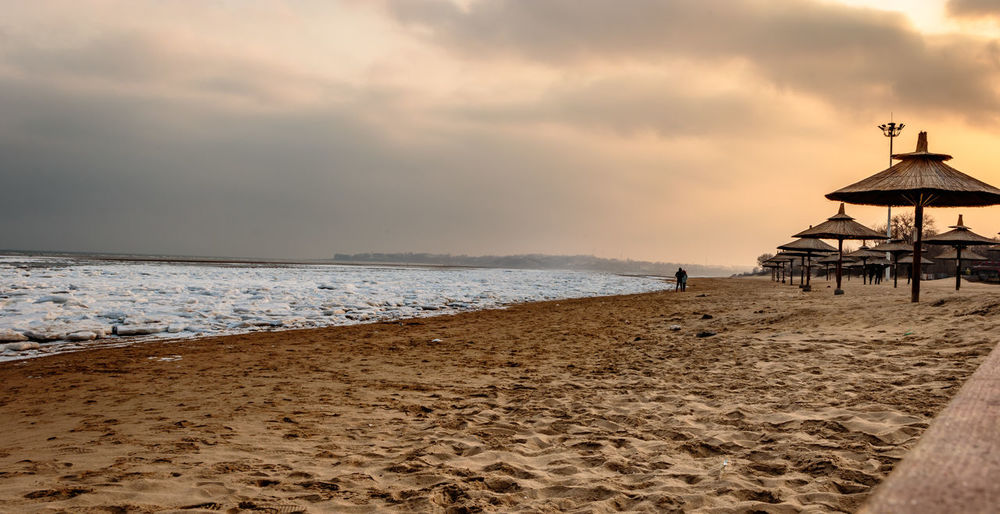 Frozen Hebei Ice Seashore Winter Beach Beauty In Nature Beidaihe Built Structure China Day Horizon Over Water Nature Outdoors Qinhuangdao Sand Sea Seascape Seaside Sky Snow Sunset Tranquility Travel Destinations Water