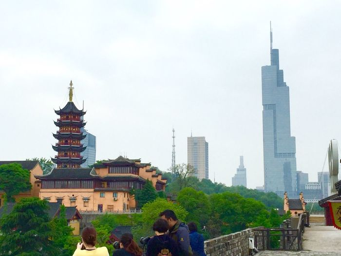 New and old. Modern and ancient. Architecture New Buildings Old Bulidings Modern Architecture Ancient Architecture Radio Tower Belltower People People Together Nanjing China 43 Golden Moments People Together By August 3 2016 Hidden Gems  Eyeemphoto People And Places