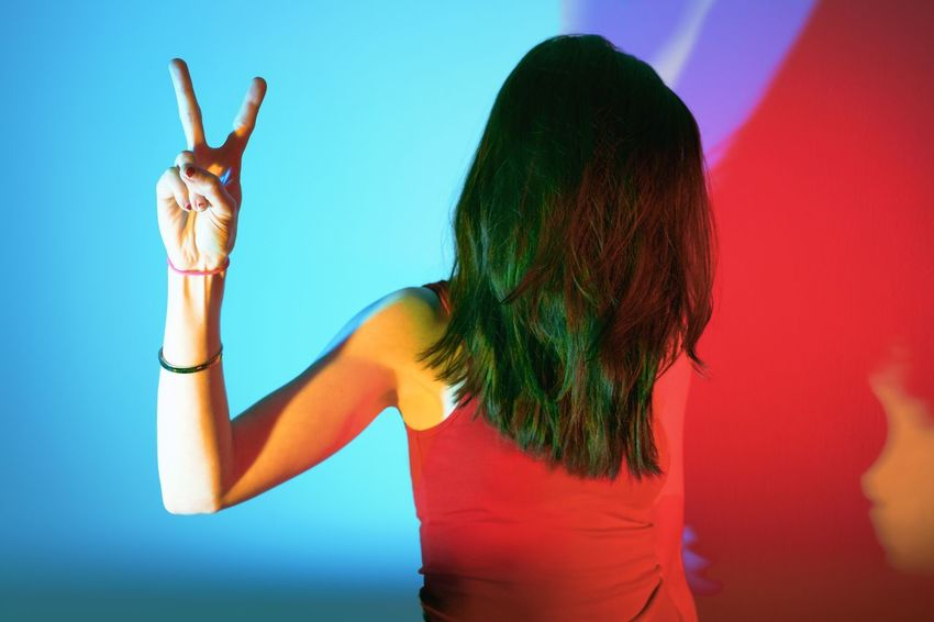 When you don't know what to do with your hands The Week on EyeEm Colorful Studio Shot Self Portrait Peace Real People One Person Gesturing Women Lifestyles Indoors  Human Hand People Inner Power
