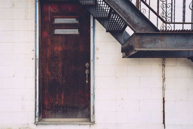 Architecture Building Exterior Built Structure Concrete Wall Day Door No People Old Outdoors Rusty Staircase Stairs Stairwell