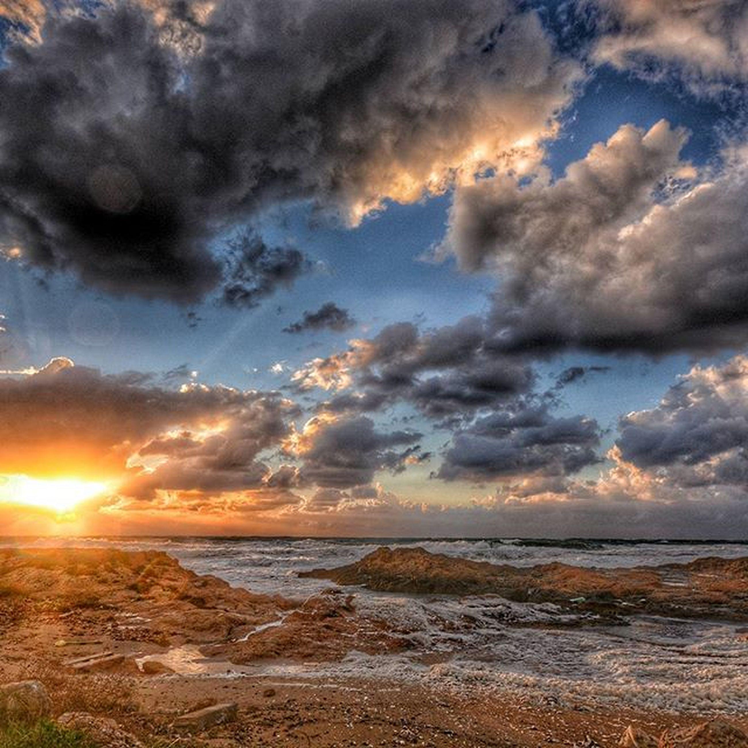 sky, sea, water, scenics, beach, cloud - sky, tranquil scene, horizon over water, beauty in nature, sunset, tranquility, shore, cloudy, nature, idyllic, cloud, sun, sunlight, sand, dramatic sky