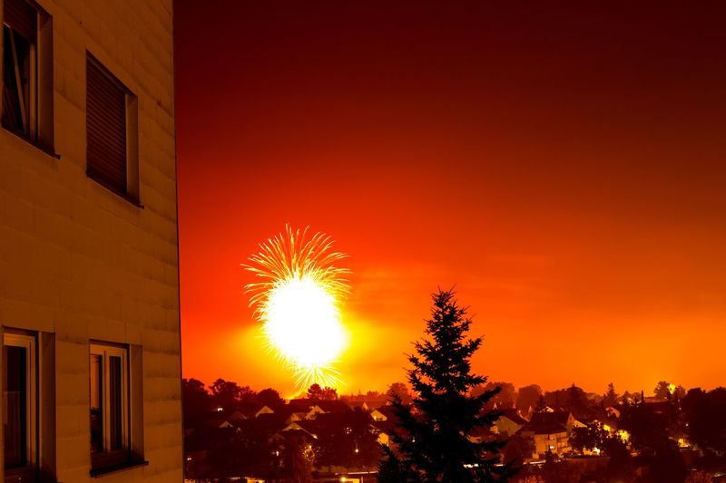 Architecture Building Exterior Built Structure Night Fireworks Explosion Window Orange Color Sky Illuminated City Outdoors No People
