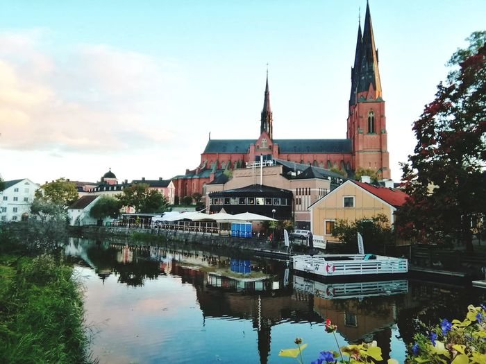 The magnificent Uppsala Cathedral seen from the Fyris river in Uppsala Sweden Uppsala Domkyrka Fyrisån Uppsala Uppsala Sweden Water Multi Colored Reflection Sky Architecture