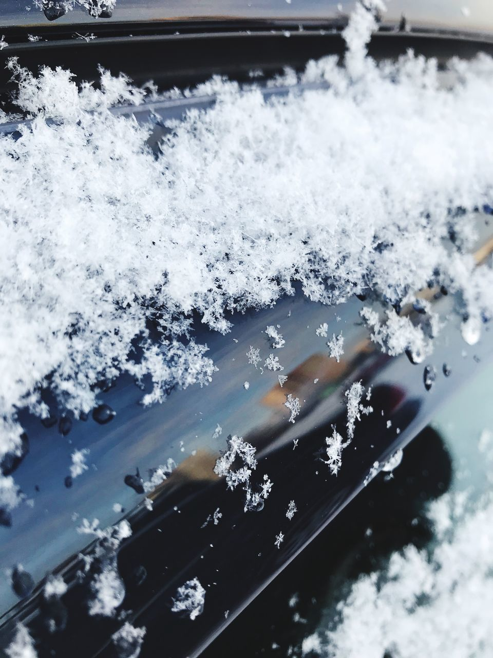 HIGH ANGLE VIEW OF SNOW COVERED CAR ON ROAD