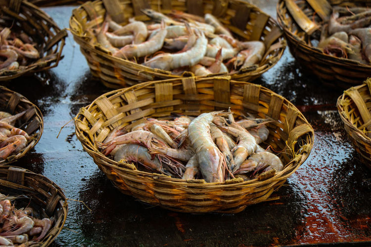 Prawn Shirmp Seafood Dried Fish  Basket Market Fish Quality Retail  High Angle View City Food And Drink Fish Market Fishes Crushed Ice Street Market Market Vendor Price Tag Squid Shop For Sale Salted Stall Fishing Industry Display Retail Display Farmer Market Market Stall