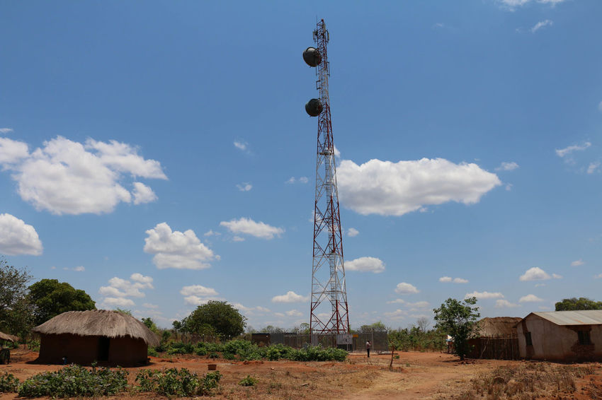 A telecommunications tower in rural Tanzania Antenna - Aerial Astronomy Broadcasting Cloud - Sky Communication Day Electricity Pylon Global Communications Landscape Nature No People Outdoors Scenics Sky Technology Telecommunications Equipment Tower