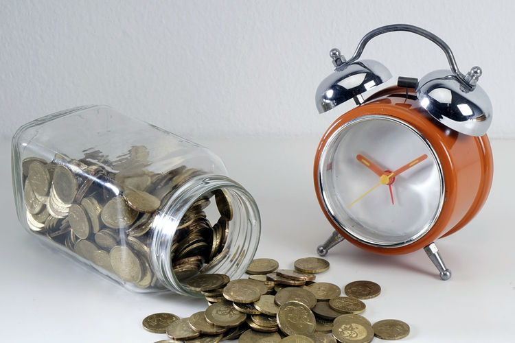 Coin Still Life Finance Wealth Indoors  Clock Jar Large Group Of Objects Container Table Business Savings No People Glass - Material Alarm Clock Close-up Transparent Time Studio Shot Investment Economy