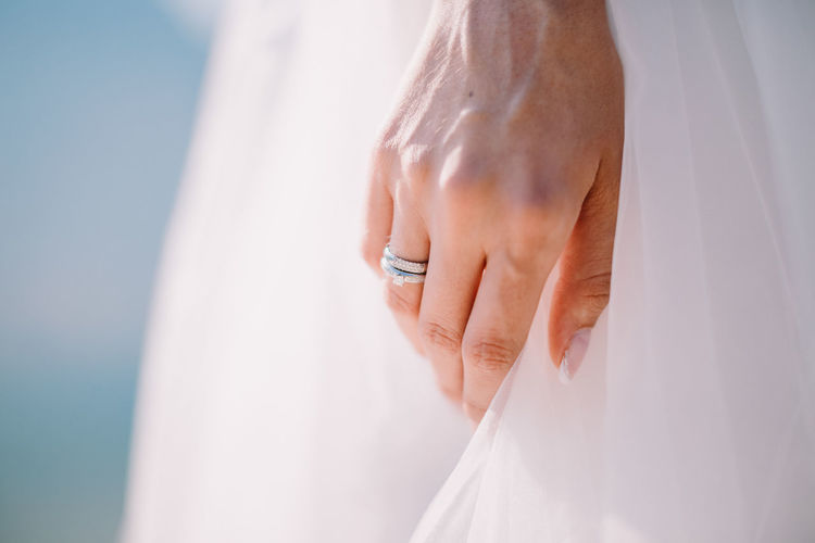 Midsection Of Bride Wearing Wedding Ring