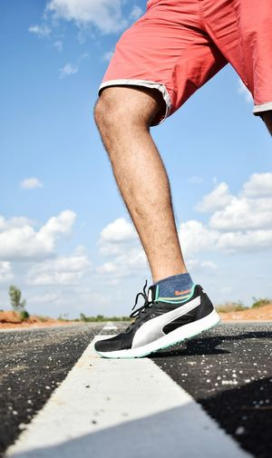Low Section Human Leg Cloud - Sky Only Men Sky One Man Only Shorts Adults Only Adult Sport One Person Day Shoe Outdoors Exercising Road Men Sports Clothing Shoes Running Sports Photography Competitive Sport Sports Sportsman Men's Track