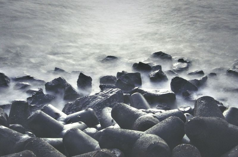 Photography In Motion Waterfront City Waves And Rocks Monochrome