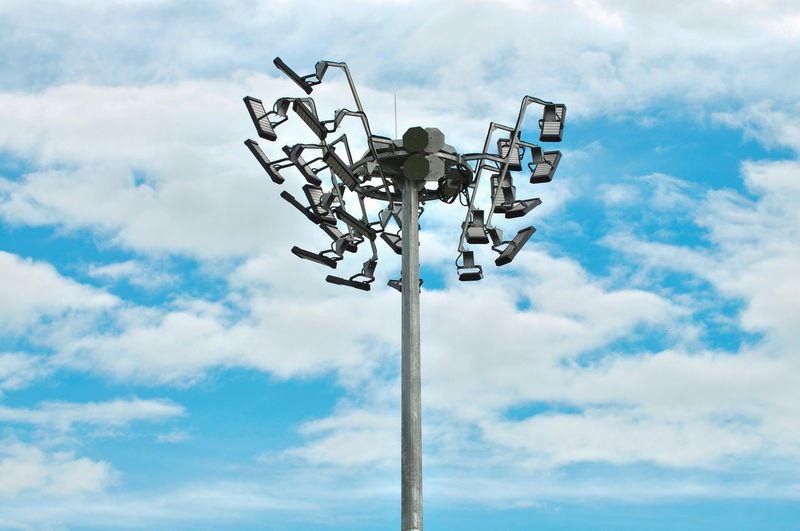 Low angle view of floodlights against sky