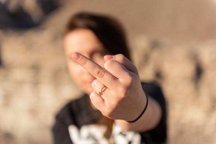 Woman showing obscene gesture