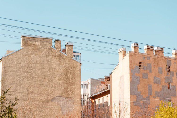 Built Structure Architecture Building Exterior Sky Low Angle View Cable Building Day Sunlight No People Clear Sky Wall - Building Feature Power Line  Residential District Outdoors Connection Blue Wall Electricity