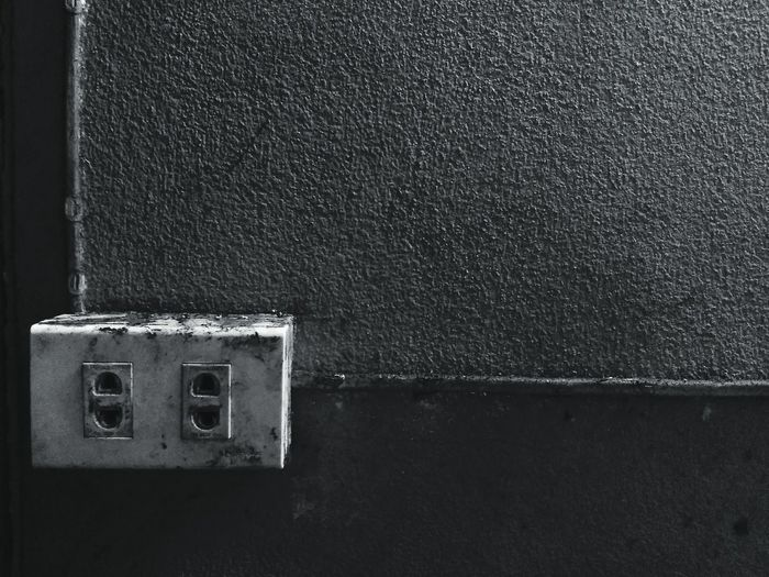 Close-up of electric switch board against wall