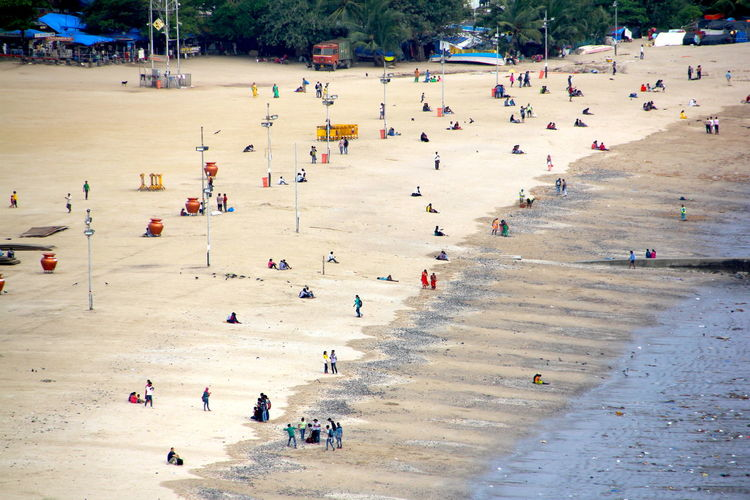 Beach Photography India Mumbai Travel Photography Architecture Beach Crowd Day Distant View Group Of People High Angle View Holiday Land Large Group Of People Leisure Activity Lifestyles Men Nature Outdoors Plant Real People Tree Trip Vacations Women Adventures In The City