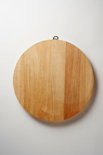 Directly above shot of wood on cutting board against white background