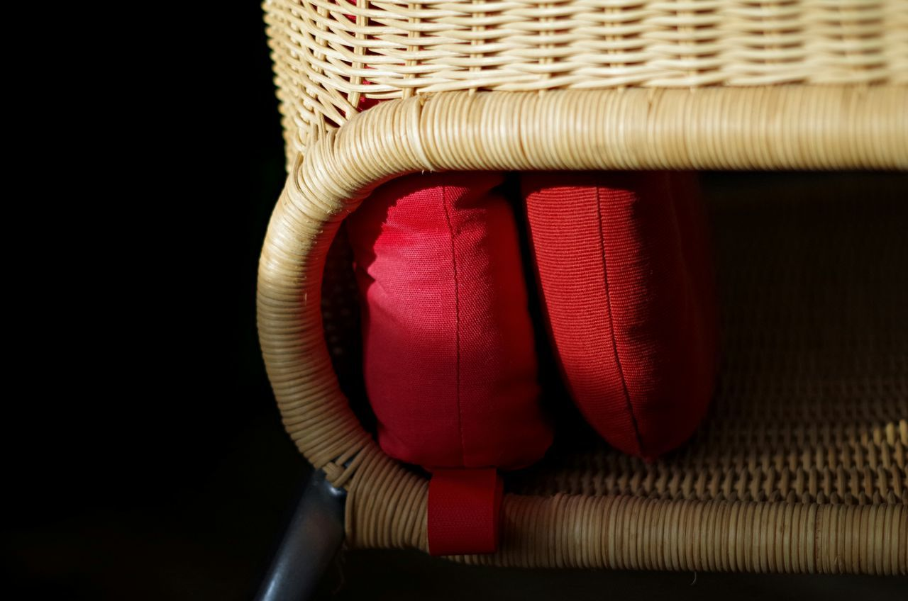 red, basket, no people, close-up, indoors, black background, studio shot, day
