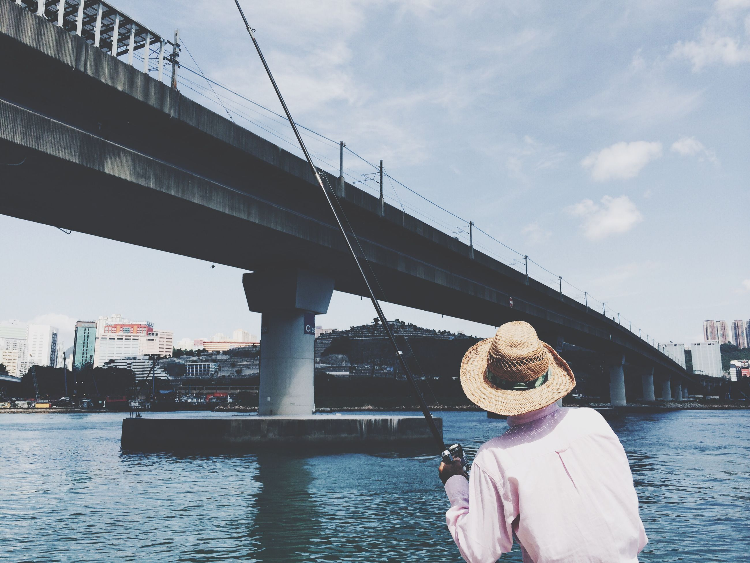 water, built structure, architecture, sky, river, transportation, bridge - man made structure, nautical vessel, connection, building exterior, waterfront, city, mode of transport, men, boat, railing, day, cloud - sky