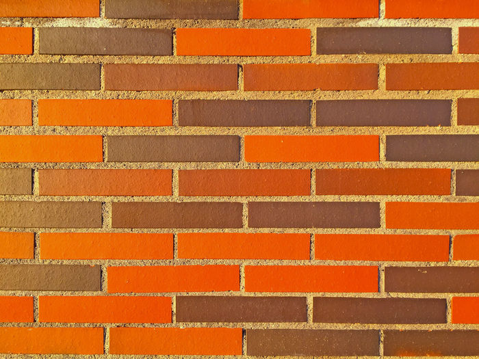Full frame shot of orange brick wall
