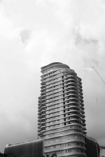 A Gloomy Day White Space Architecture Black And White Blackandwhite Building Exterior Built Structure City Cloud - Sky Day Industrialization Lone Building Low Angle View Modern No People Outdoors Sky Skyscraper Slanting