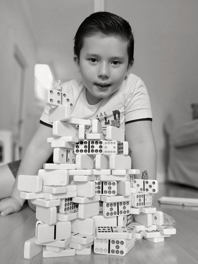 Portrait of boy with domino at home