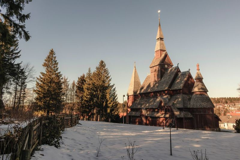 A wooden church in Hahnenklee, Germany. EyeEm Selects Tree Sky Built Structure Architecture Snow Building Exterior Plant Nature Cold Temperature Winter Building Religion Place Of Worship Belief No People Travel Destinations Clear Sky Tower Day Outdoors