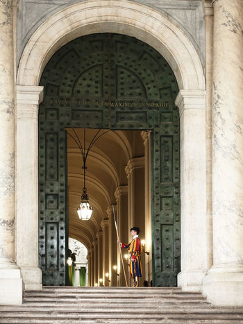 Arch Architectural Column Architecture Building Exterior Built Structure City Day Full Length History Lifestyles Men One Person Outdoors People Place Of Worship Real People Schweizer Garde Travel Travel Destinations Vatikan