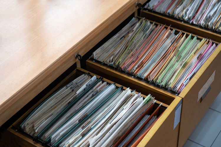 High angle view of files in drawers