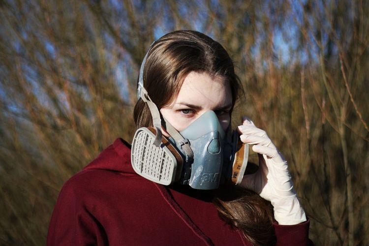 Portrait of woman wearing gas mask