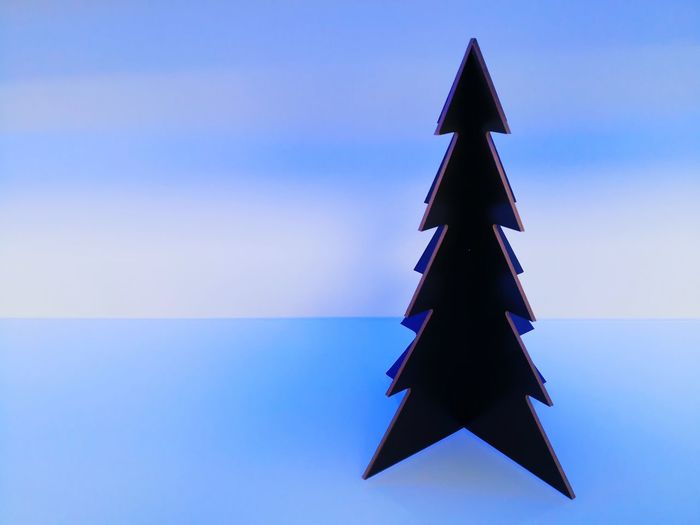Triangle Shape Christmas Tree Christmas No People Blue Christmas Decoration Studio Shot Christmas Free Space For Text Backround Single Object Celebration Tradition Colored Background Neutral