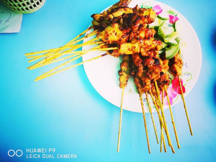 Satay- one of Malaysian's favourite finger food!! The aroma of charcoal burning is making it special.EyeEm Selects Food Foodphotography Foodporn Foodstagram Foodies Malaysian Traditional Food Malaysian Food Malaysianstreet Foodlovers Satay With Bamboo Stick Sataychicken Huawei P9 Photos Huaweimobile Huawei Leica HuaweiP9 Huaweiphotography