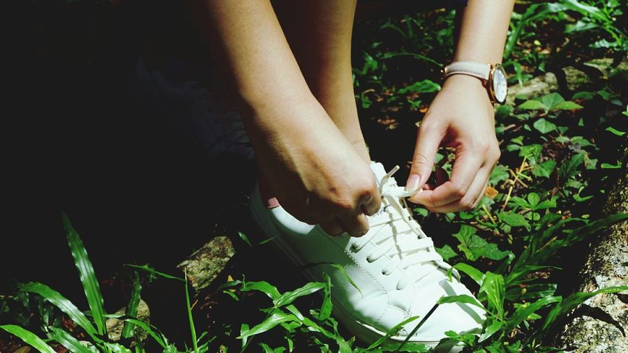 Tighten up... Shoes Watch Adults Only Only Women Human Hand People Green Color Outdoors Close-up Lifestyle Tropical Climate Phototography Photographer Sony A6000 Eyeemphoto Vscocam Cool EyeEm Best Shots White Color