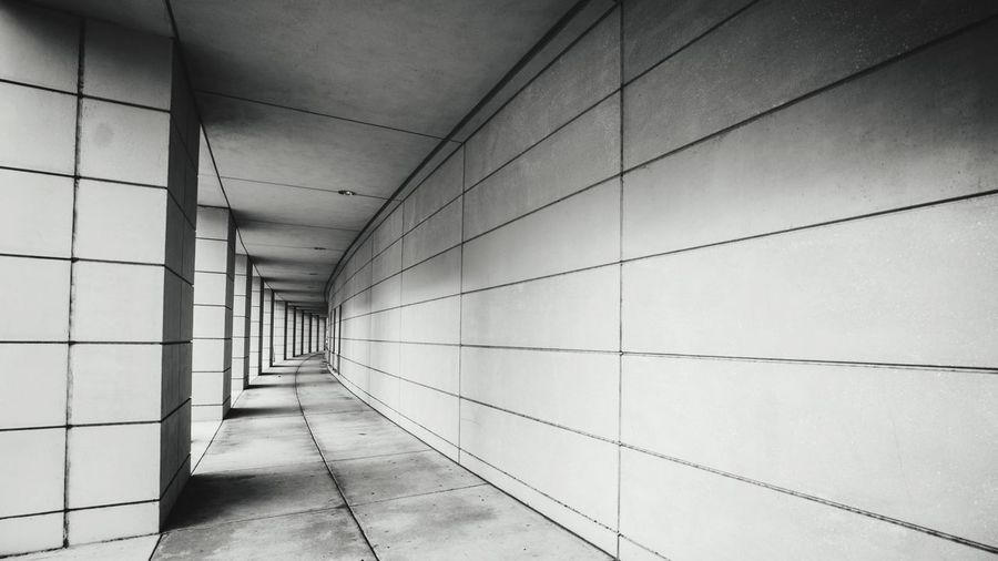 Turning Architecture Built Structure Wall - Building Feature No People Arcade Indoors  Building Corridor The Way Forward Flooring Diminishing Perspective Wall Security Direction Empty Ceiling Day Pattern