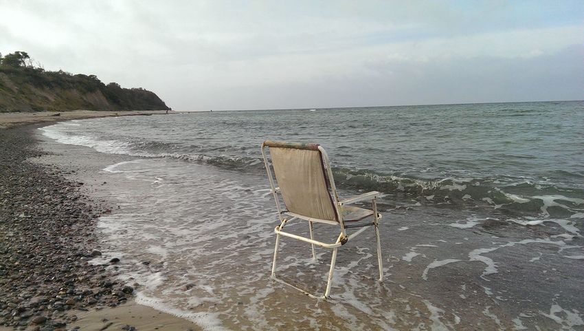 Beach Beauty In Nature Chair Day Horizon Over Water Nature No People Outdoors Sand Scenics Sea Sky Tranquil Scene Tranquility Water