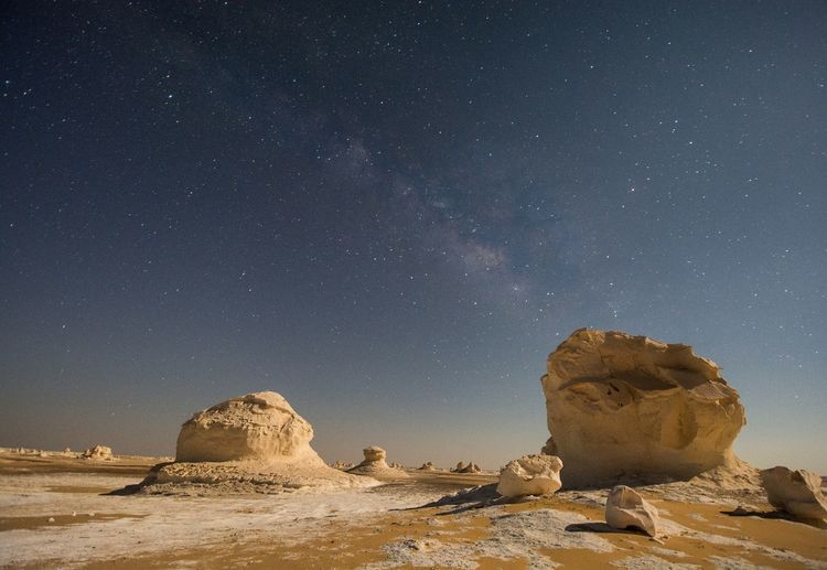 Scenic View Of Rocks And Stars At Night