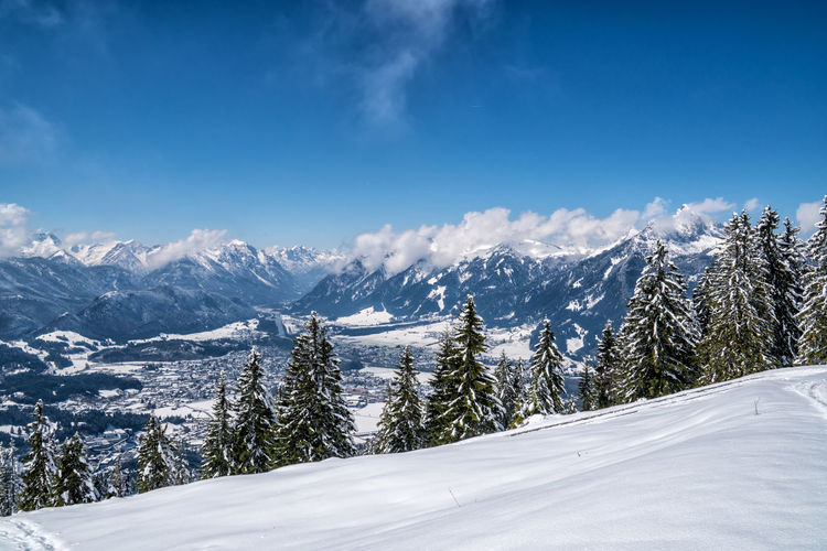 Snow Covered Mountains Against Blue Sky