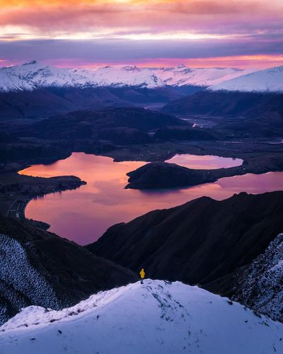 Perspectives On Nature Alone 1500m above sea level. What better place to watch a sunset. Sunset Beauty In Nature Scenics Mountain Nature Cloud - Sky Tranquil Scene Snow Tranquility Sky Winter Landscape Dramatic Sky Cold Temperature Mountain Range Outdoors One Person Hiking Adventure Travel Destinations Light Exploring Travel New Zealand
