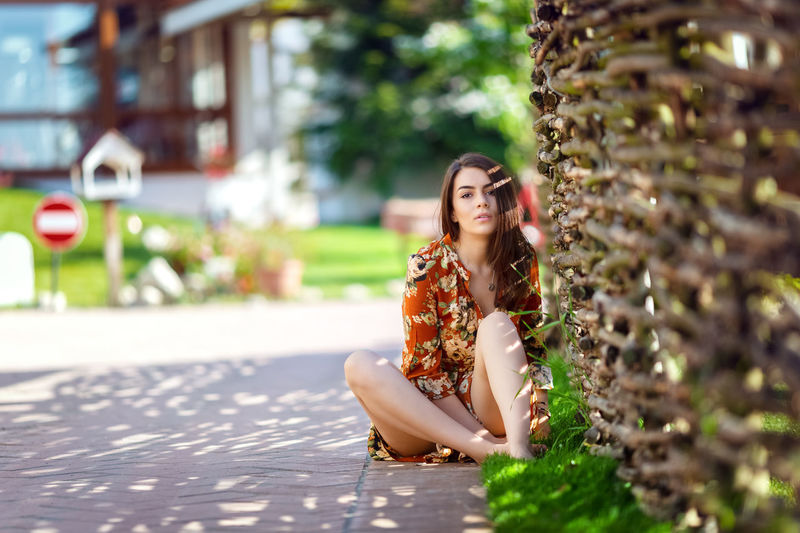 Portrait of woman sitting outdoors
