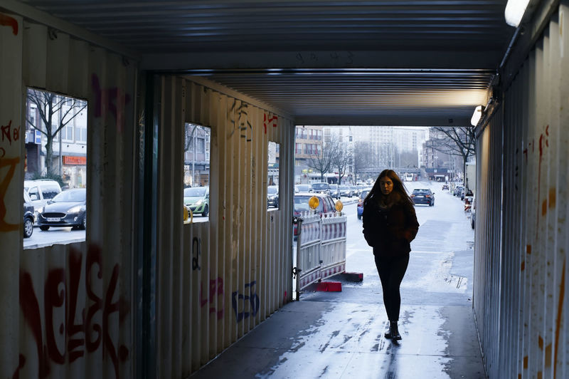 Woman standing on road in snow