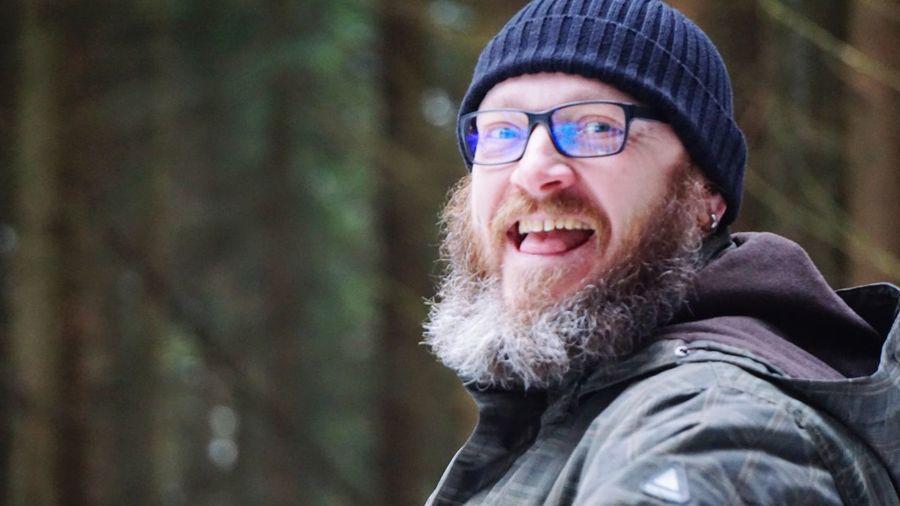 Close-Up Portrait Of Man Wearing Eyeglasses During Winter