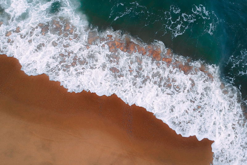 aerial view of sea waves water texture background Water Motion Sea Surfing Aquatic Sport Nature Beauty In Nature Wave Splashing Sport High Angle View Day Rock Power In Nature Outdoors Blurred Motion Rock - Object Close-up Flowing Water Breaking