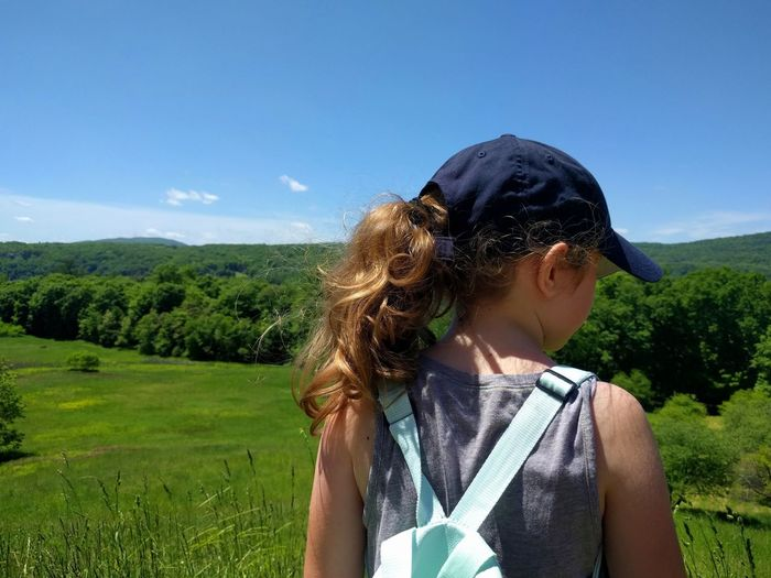 Girl in valley Sky Plant Hairstyle Nature Real People Leisure Activity Child One Person Lifestyles Childhood Day Land Field Hair Casual Clothing Environment Landscape Girls Women Rear View Outdoors Girl Young Girl Little Girl Children Park Valley Valleys