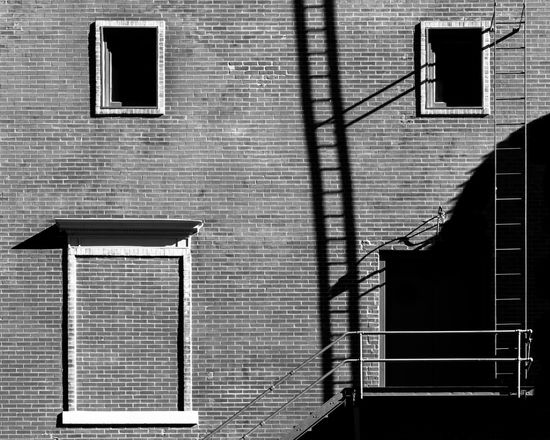 Creativity Composition Building Exterior Built Structure Architecture Blackandwhite Building Urban Urban Geometry Arrangement Background Light And Shadow Shadow Contrast Ladder Window Welcome To Black Black And White Friday EyeEm Ready   AI Now The Graphic City Visual Creativity #urbanana: The Urban Playground