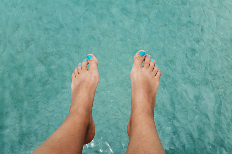 Female feet with painted toenails hanging over the beautiful Caribbean sea in summer. Barefoot Beach Blue Close-up Day Destination Feet High Angle View Holiday Human Body Part Human Foot Love Low Section Nail Polish One Person Outdoors Paradise Sea Summer Tropical Turquoise Vacation Vacations Water Woman
